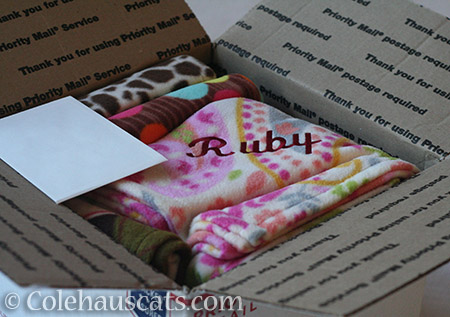 Huge box of personalized kitty blankies - © Colehauscats.com